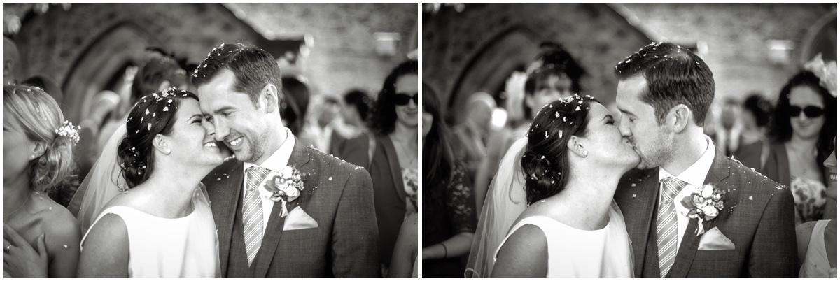 black and white image of wedding couple kissing