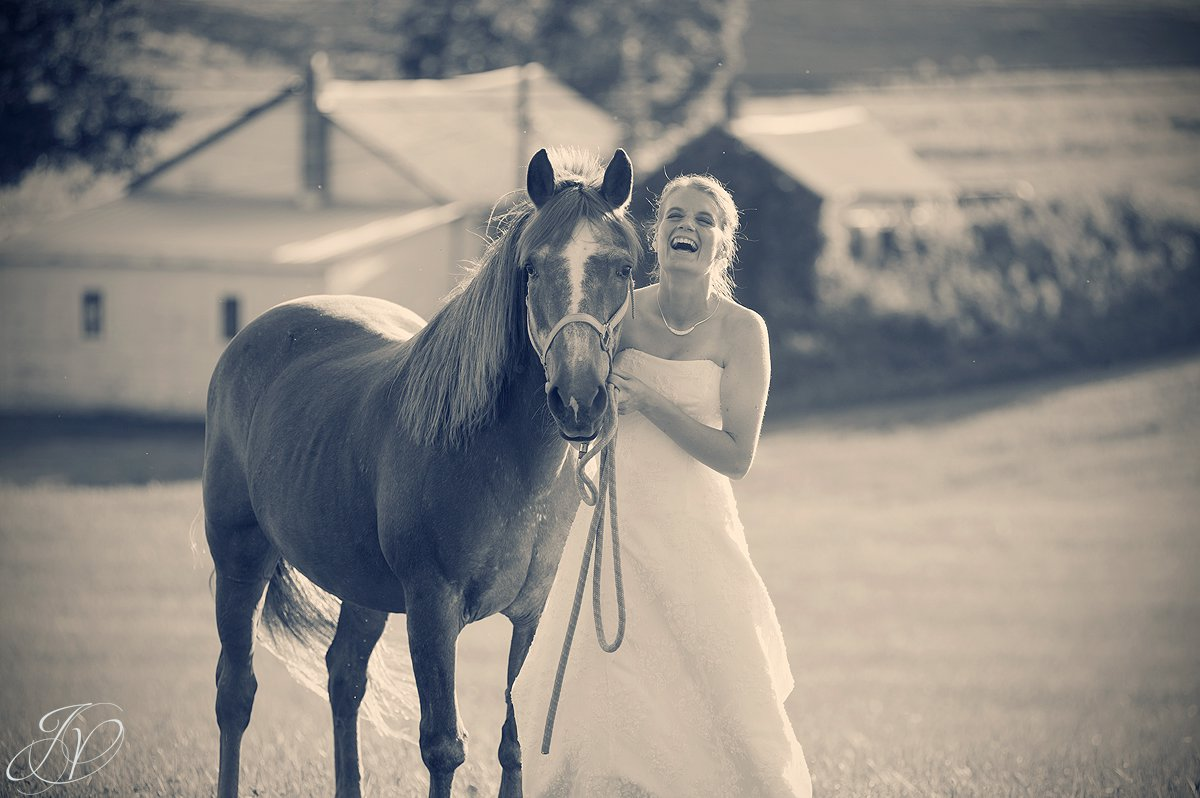 Saratoga Wedding Photographer, upstate wedding photographer, outdoor wedding photo, bride with horse, candid bride photo