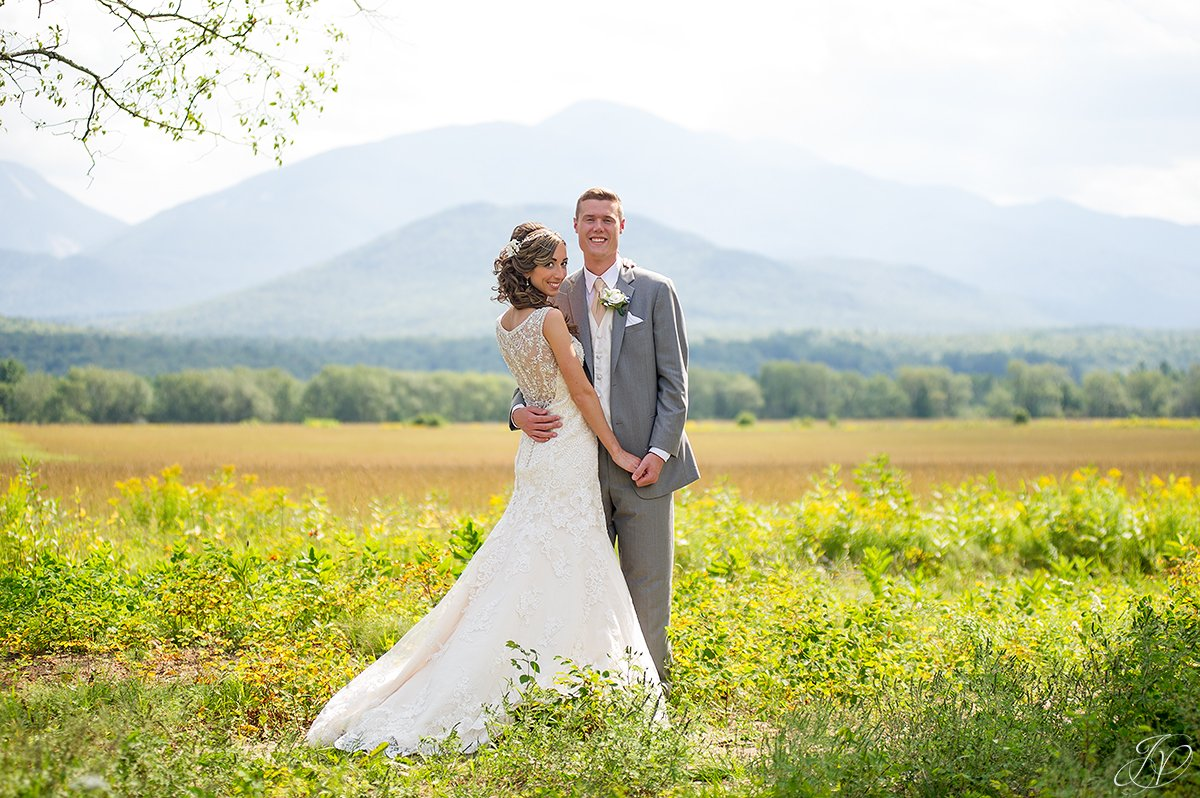 bridal portrait in front of mountain lake placid
