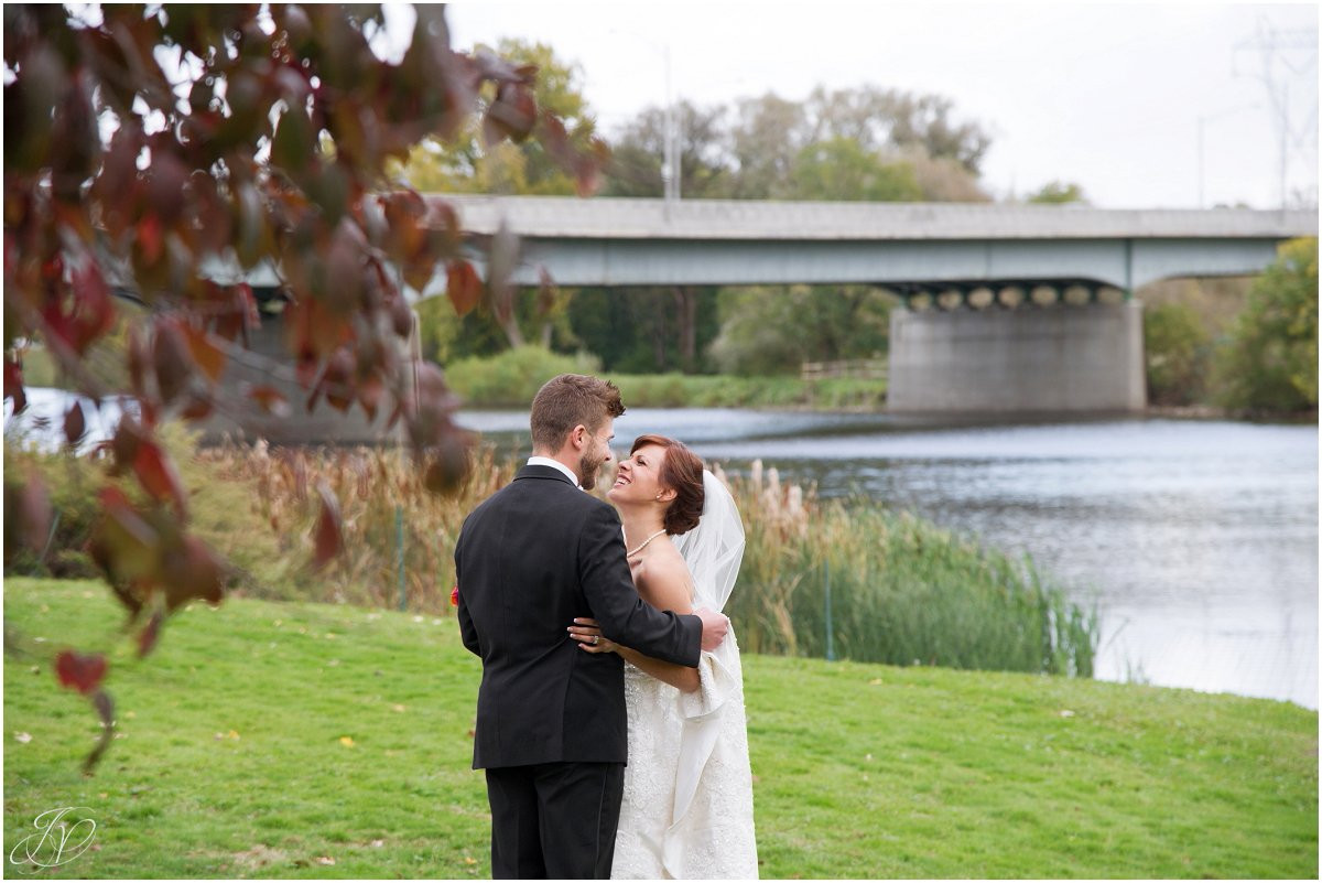 bride and groom laughing waterfront glen sanders mansion wedding
