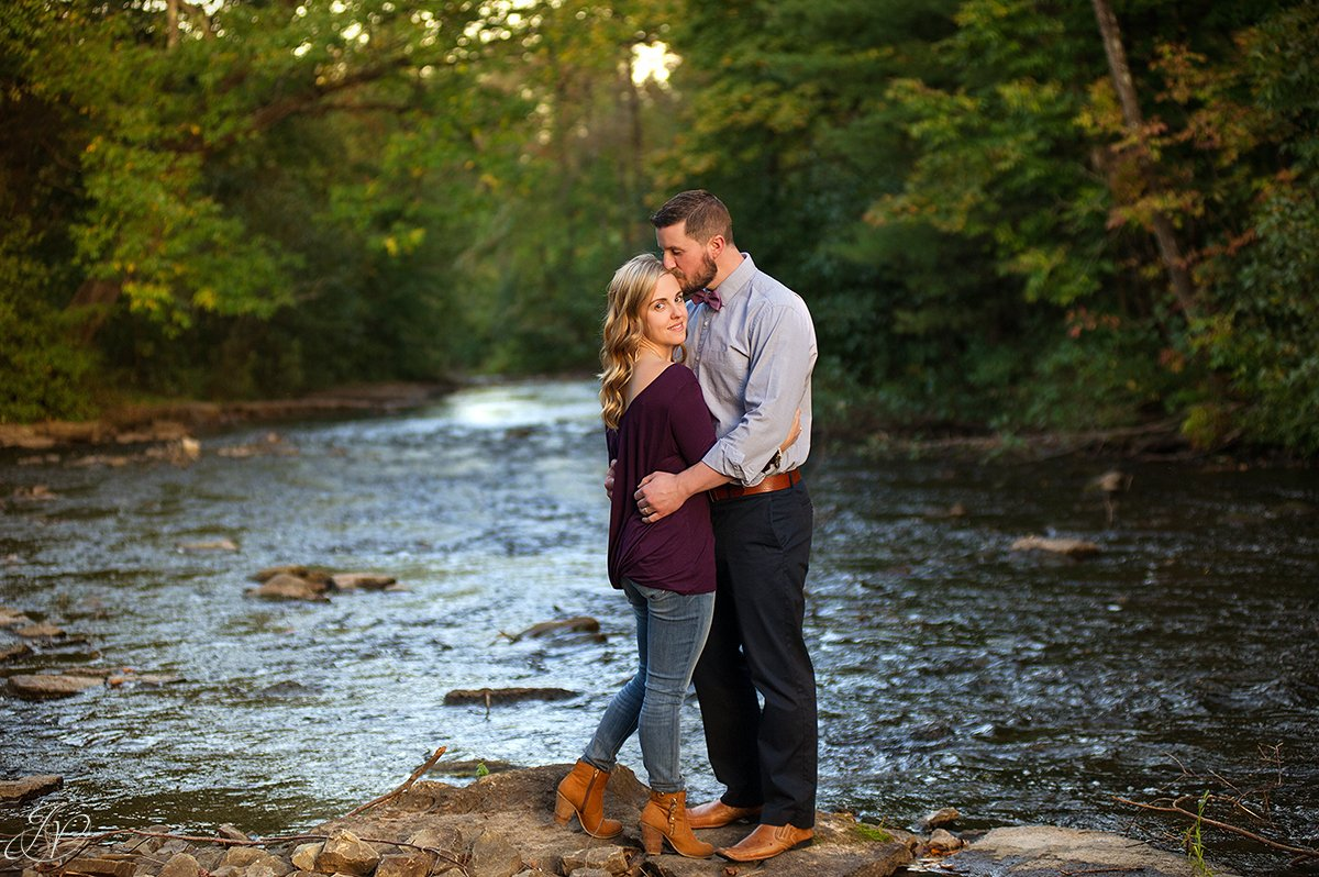 romantic couple portrait fall water saratoga springs head kiss