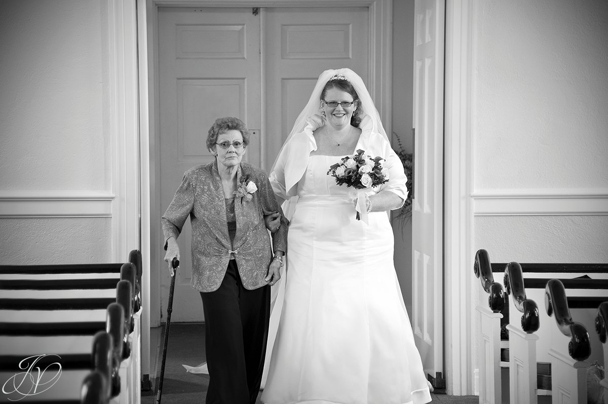 bride and mother photo, bride walking mother, wedding ceremony photo, Wedding at The Queensbury Hotel, Lake George Wedding Photographer