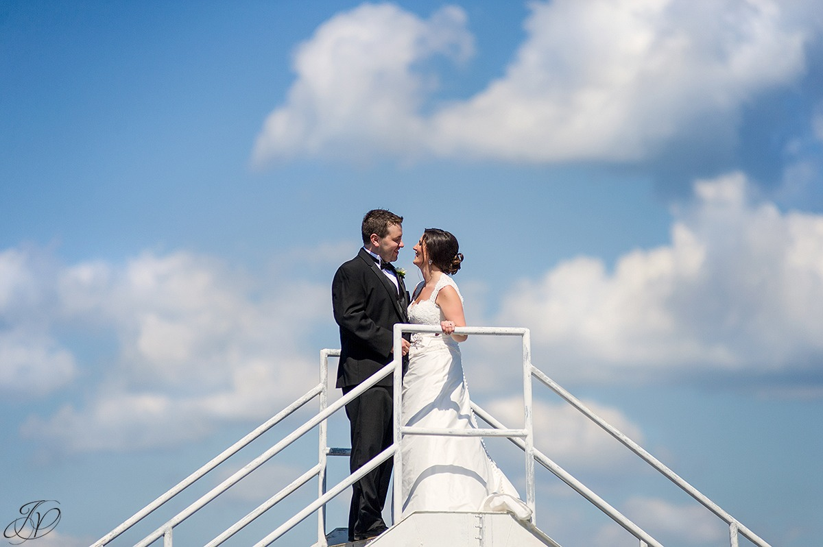unique photo of bride and groom with sky in background