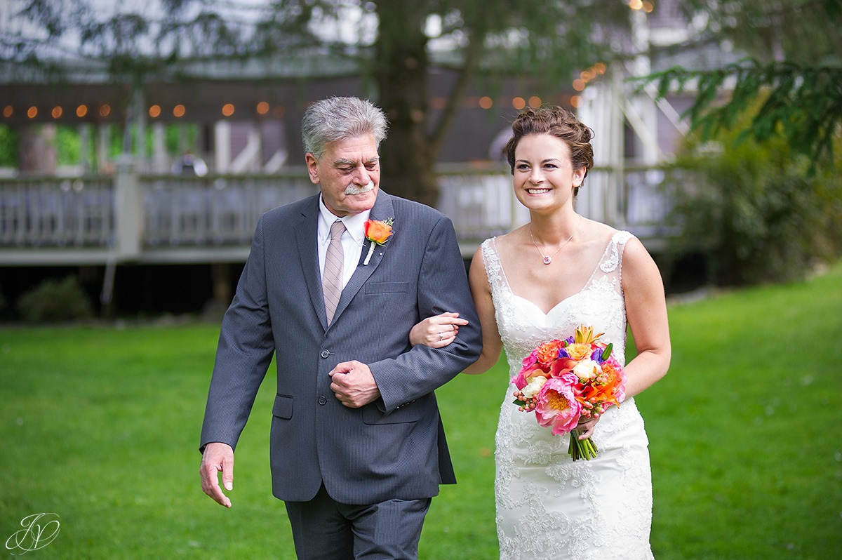 bride walking down aisle with her dad
