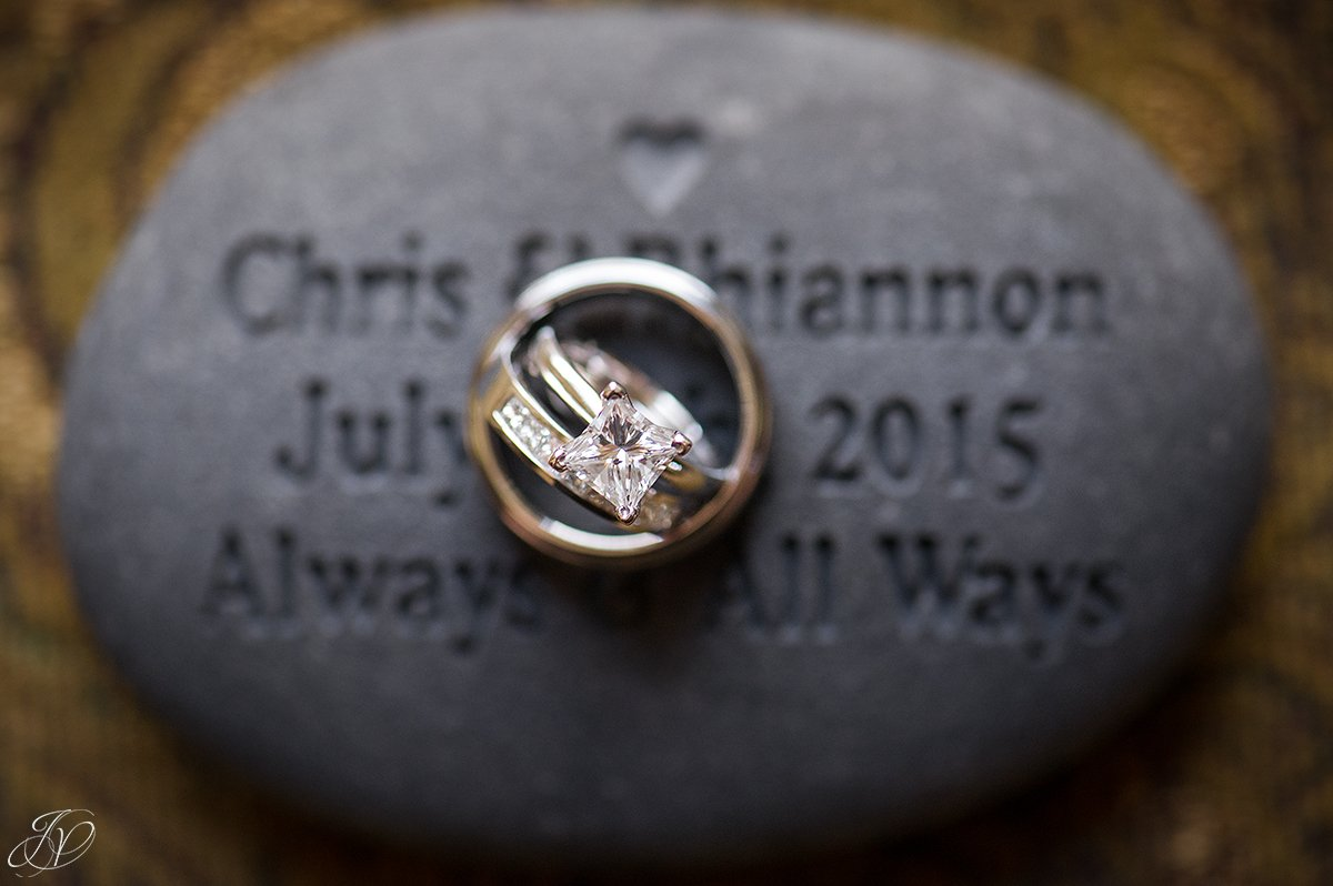 wedding rings on a custom engraved stone
