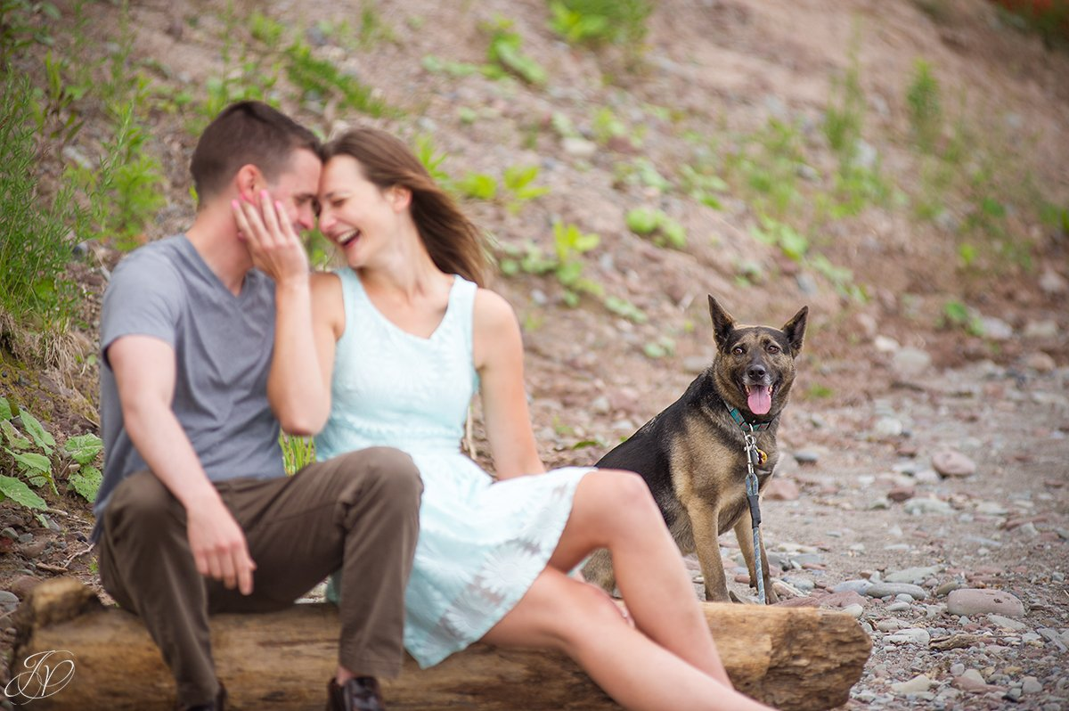 beachfront engagement photo with pet