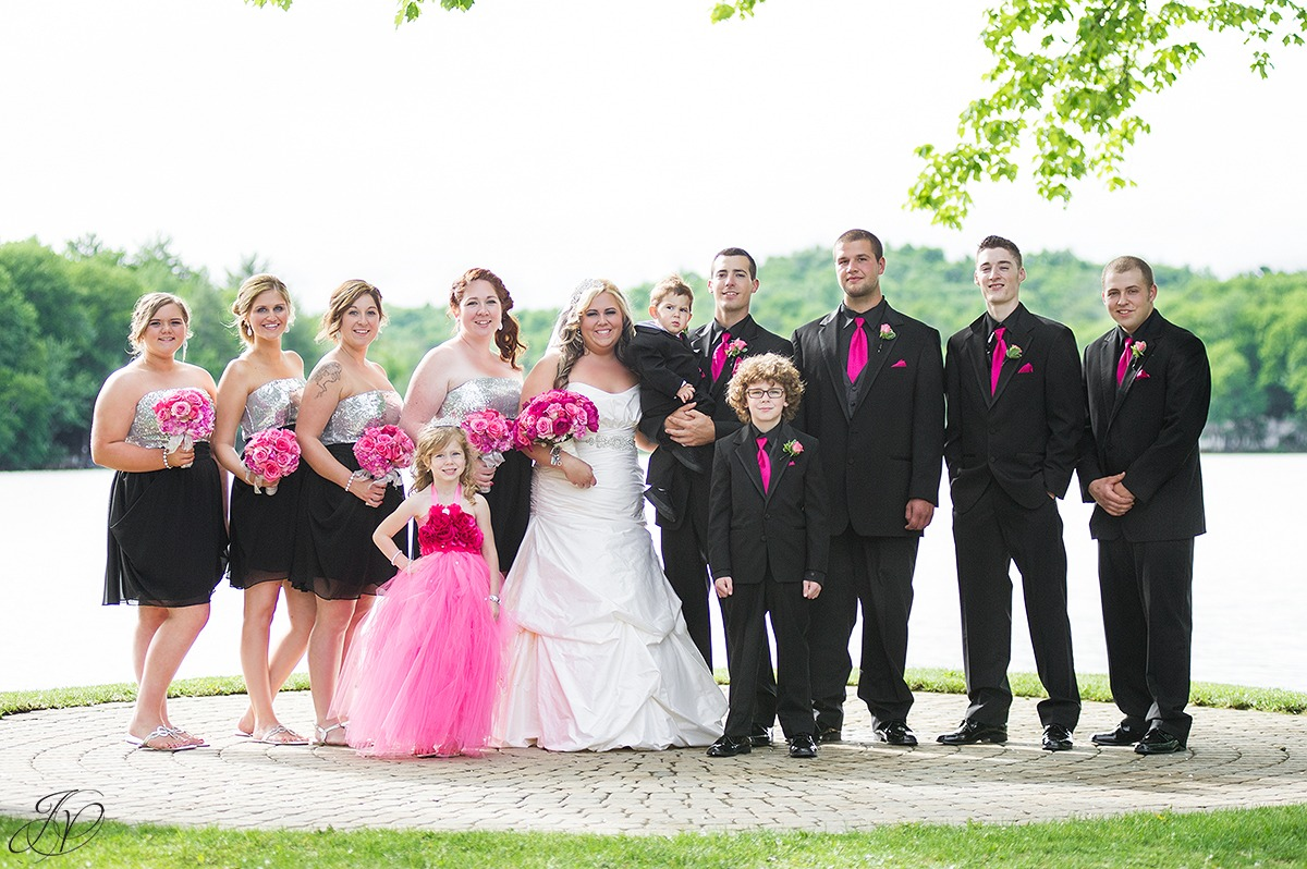 wedding party photo in front of a lake