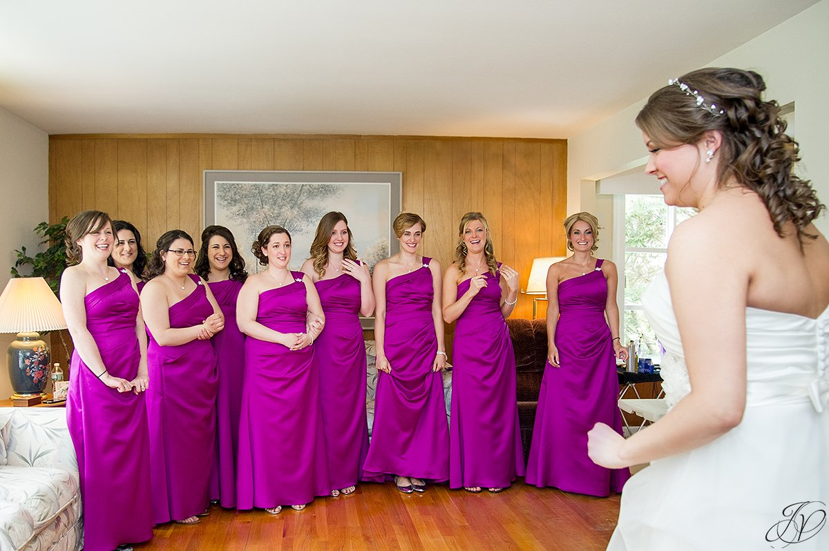 creative first look with bridesmaids