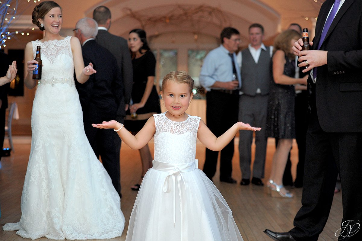 adorable flower girl dancing at reception