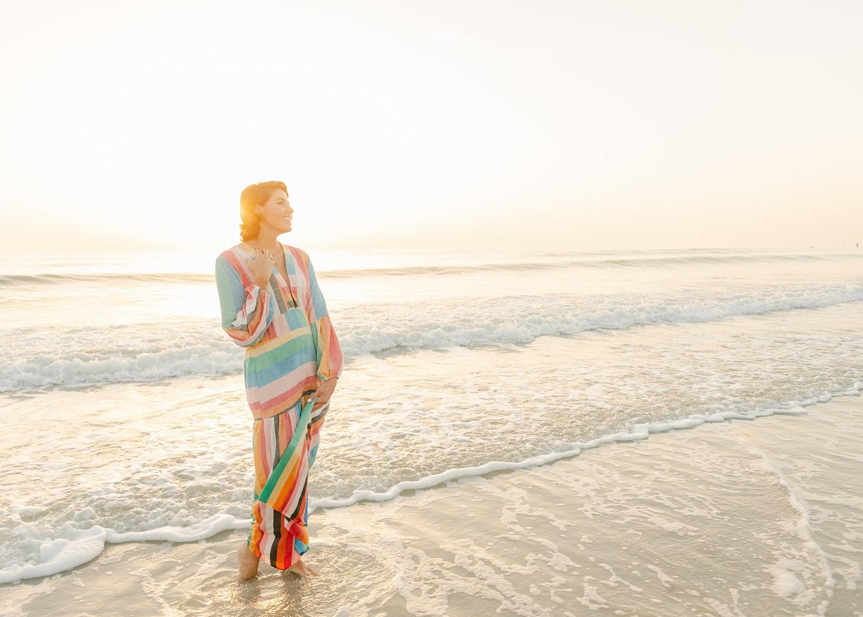 cancer survivor wearing a rainbow dress, Florida coastline, Ryaphotos