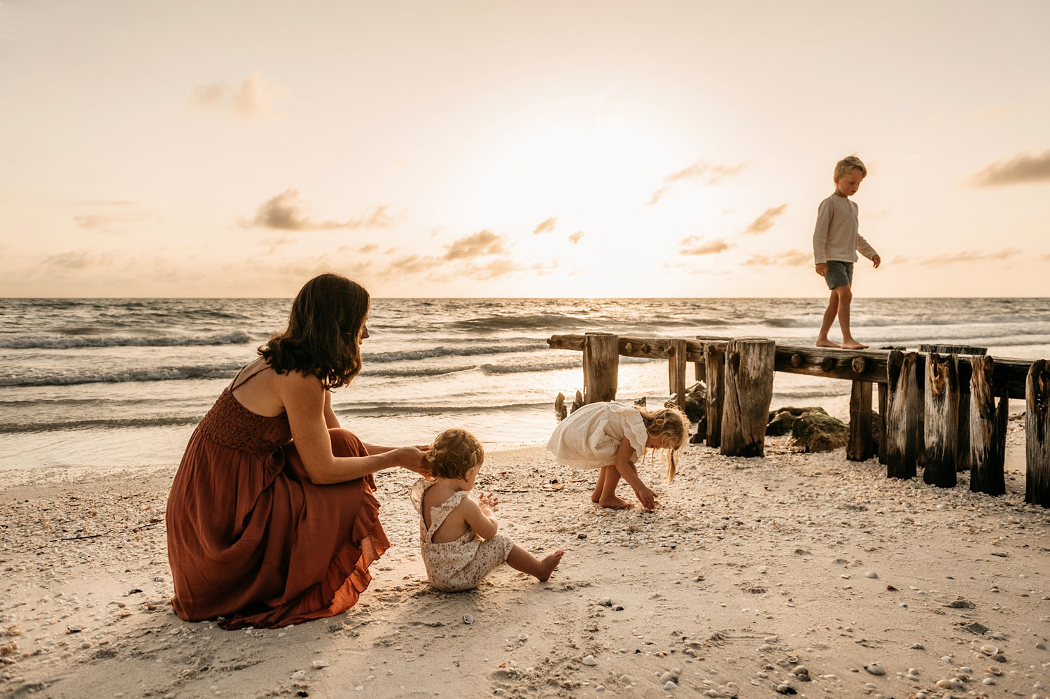 simple family beach portraits, mother and children playing at the beach at sunset, Rya Duncklee Photography